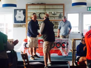 Race prize being presented to Anthony O'Leary by Jim Griffiths of Beacon Properties