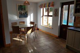 Dining area with door to garden